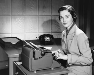 Woman typing on type writer